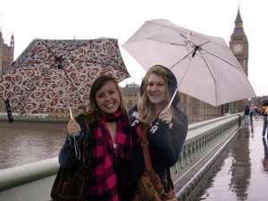 Two girls in London with Umbrellas